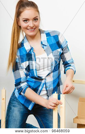 Woman Assembling Wooden Furniture. Diy.