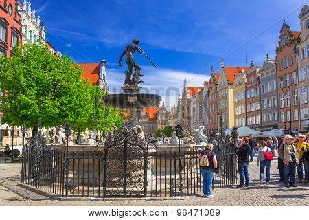 GDANSK, POLAND - MAY 11, 2015: Fountain of the Neptune in old town of Gdansk, Poland. The bronze statue of Neptune made in 16th century is one the most recognizable symbols of Gdansk.