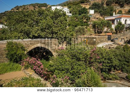Picturesque Stone Bridge In The Flowers On The Island Of Andros, Greece