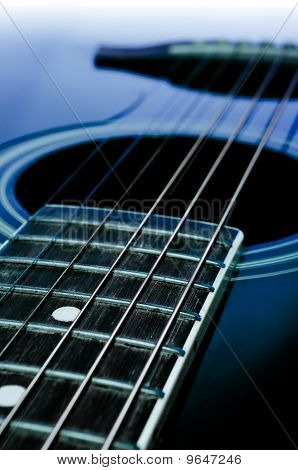 Black  acoustic guitar close-up