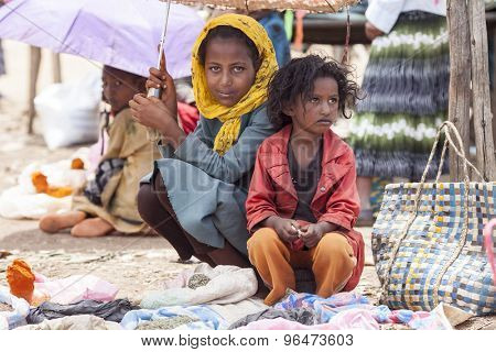 ADDIS ABABA, ETHIOPIA-APRIL 22, 2015: A young woman and her sister sell spices in a market in Ethiopia