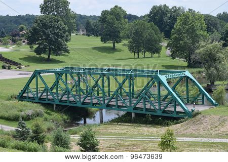a teal colored bridge