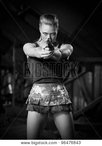 Young woman in uniform with gun (monochrome version)