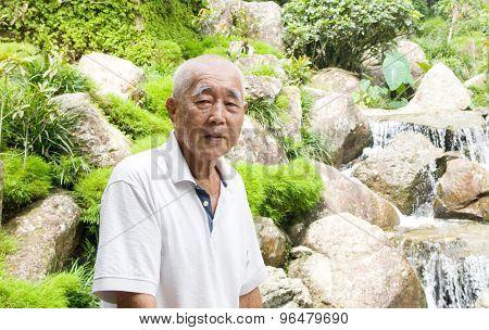 Smiling asian senior man.