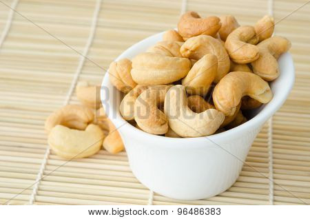 Cashew Nuts With Salt In White Bowl.