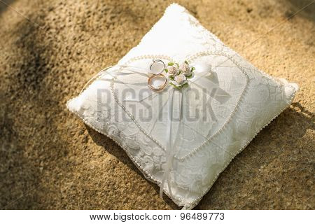 Golden Wedding Rings On A Pillow.