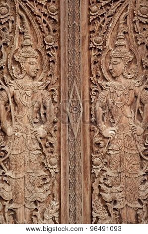 Thai molding art on the wall made of wood,