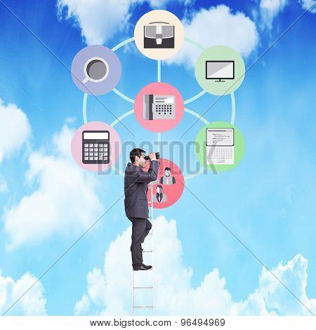 Businessman standing on ladder against bright blue sky