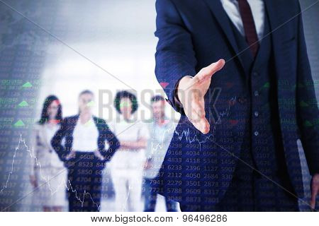 Businessman ready to shake hand against stocks and shares