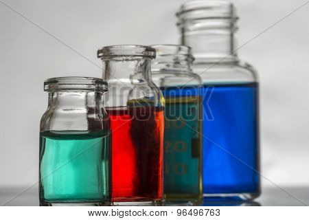 Set of laboratory bottles with color liquid