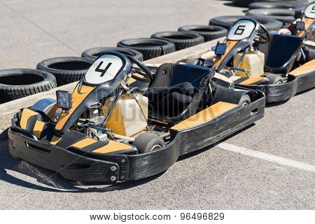high speeds, racing, extreme sport and vehicle concept - close up of kart on speedway track
