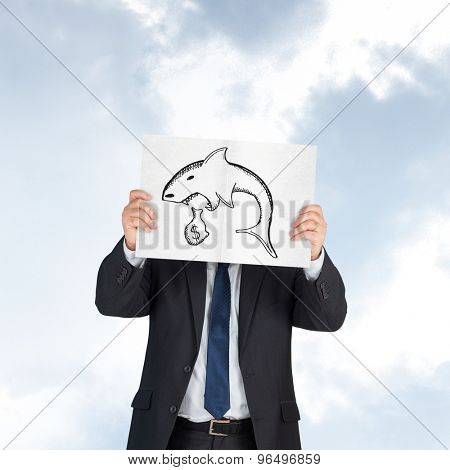 Mature businessman showing card against blue sky
