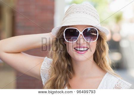 Portrait of a pretty hipster woman enjoying the sun