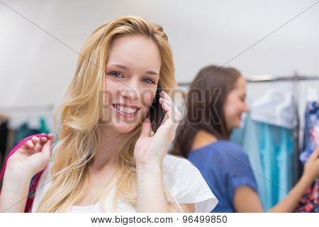 Portrait of a pretty blonde talking on the phone