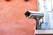 picture of cctv  - Brown grunge textured concrete wall with CCTV - JPG