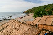 picture of beach hut  - Straw hut roofs and beach view in arambol goa india - JPG
