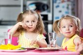picture of daycare  - Cute children drinking and eating at daycare - JPG