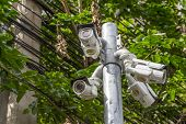 stock photo of cctv  - Multiple Angle Outdoor CCTV Camera on the Pole - JPG