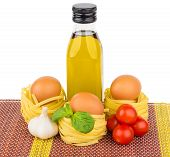 stock photo of glass noodles  - Olive oil Italian noodles tomatoes garlic and basil isolated on bamboo mat - JPG