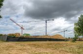 pic of construction crane  - Construction site with cranes - JPG