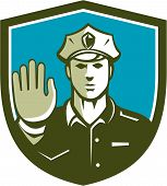 image of policeman  - Illustration of a traffic policeman police officer holding hand up stop sign set inside shield crest done in retro style on isolated background - JPG