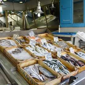 pic of piraeus  - Retail mediterranean sea fish in wooden crates with ice on a shop of Piraeus port in Greece near Athens - JPG