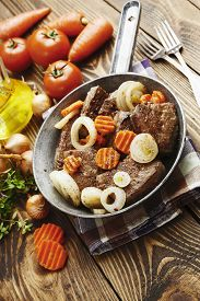 image of liver fry  - Liver fried with carrot and onion in a frying pan - JPG