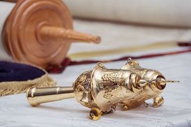 foto of scroll  - Hebrew text of the Torah the wood parchment scroll and gold cap with a bells - JPG