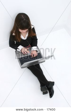 Girl Child Sitting On Floor With Laptop Computer