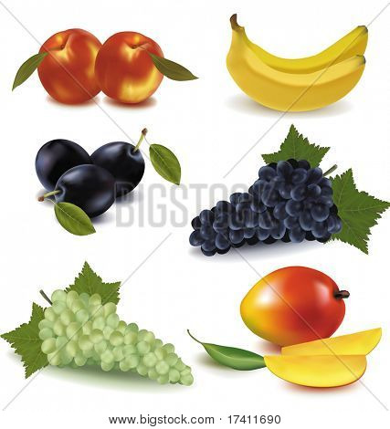 Peaches, plums, banana, green and blue grapes and mango with leaves