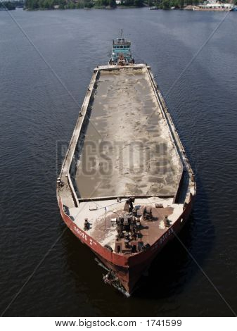 Tug Boat With Barge