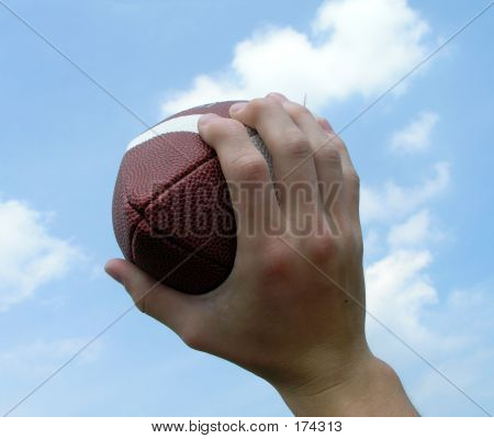 Holding Up A Football