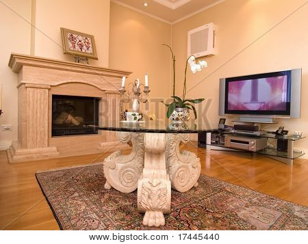 interior of a modern living room with a fireplace