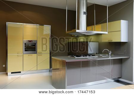 interior of a modern yellow kitchen