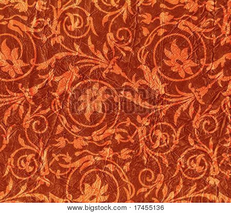 Expensive red crumpled fabric with flower pattern
