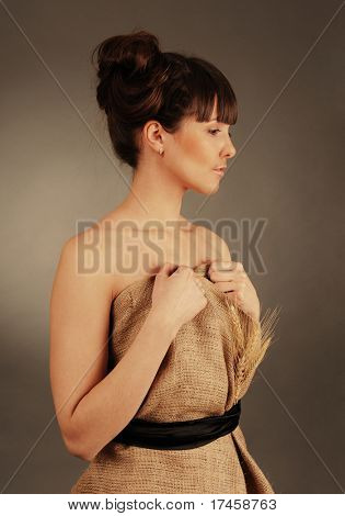 Beautiful young woman dressed in clothes made of natural fabric.