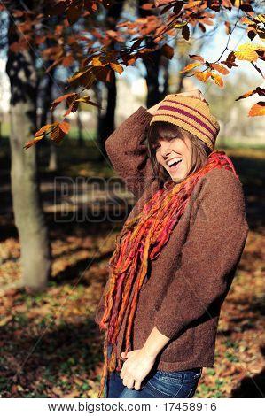 Smiling happy girl in autumn park. Outdoor.