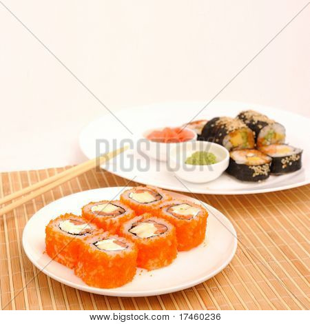 Rolls with caviar chaplain and salmon.