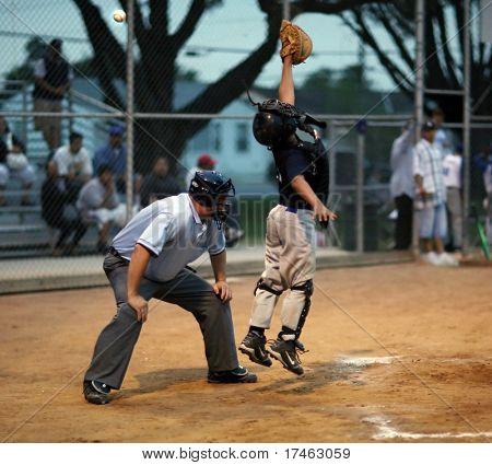 Baseball Catcher Reaching For Ball