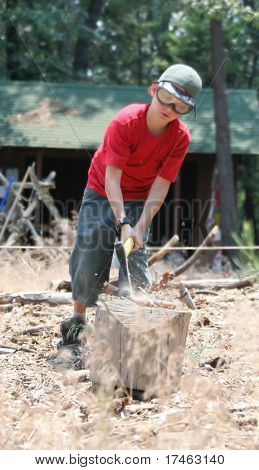Young Boy Splitting Logs