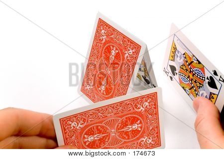 Hands Building A House Of Cards