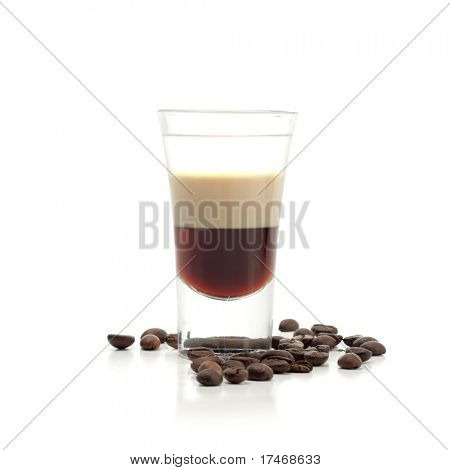 Hard Drink made of three Liqueur: Coffee Liqueur, Cream with Irish Whiskey. Coffee Crop Garnish. Isolated on White Background.