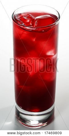 Red Alcoholic Cocktail made of Lychee Liqueur, Pineapple Juice and Cranberries Juice with Ice Cube