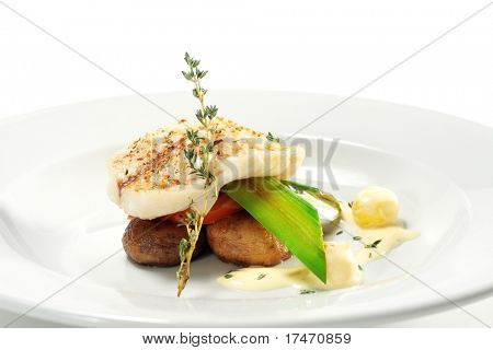 Halibut on Vegetable with Sauce. Isolated on White Background