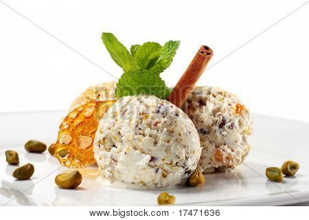 Pistachio Ice Cream with Fresh Mint and Cinnamon. Isolated on White Background