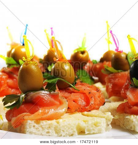 Delicious Appetizer Plate with Salmon and Olives. Isolated on White Background