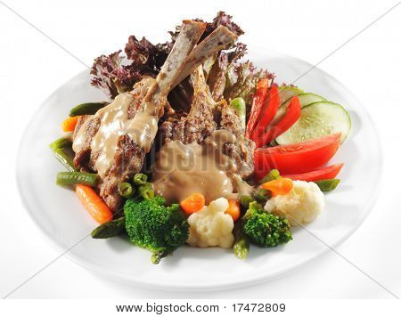Hot Meat Dishes - Prime Rib Roast Pork with Fresh Vegetables. Isolated on White Background