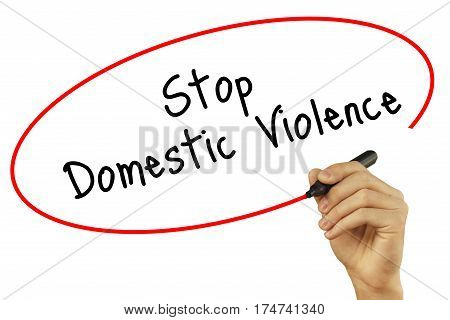 Man Hand Writing Stop Domestic Violence With Black Marker On Visual Screen. Isolated On Background.