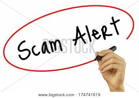 Man Hand Writing Scam Alert With Black Marker On Visual Screen. Isolated On Background. Business, Te