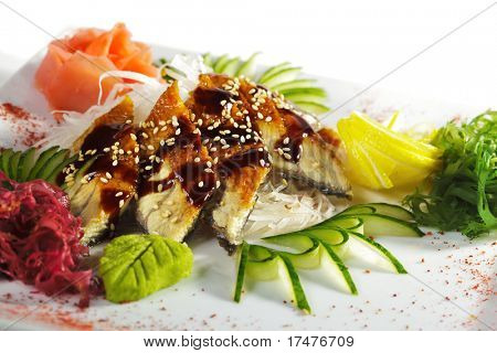 Unagi Sashimi - Smoked Eel on Daikon (White Radish) with Eel Sauce and Sesame. Served with Seaweed, Cucumber and Lemon